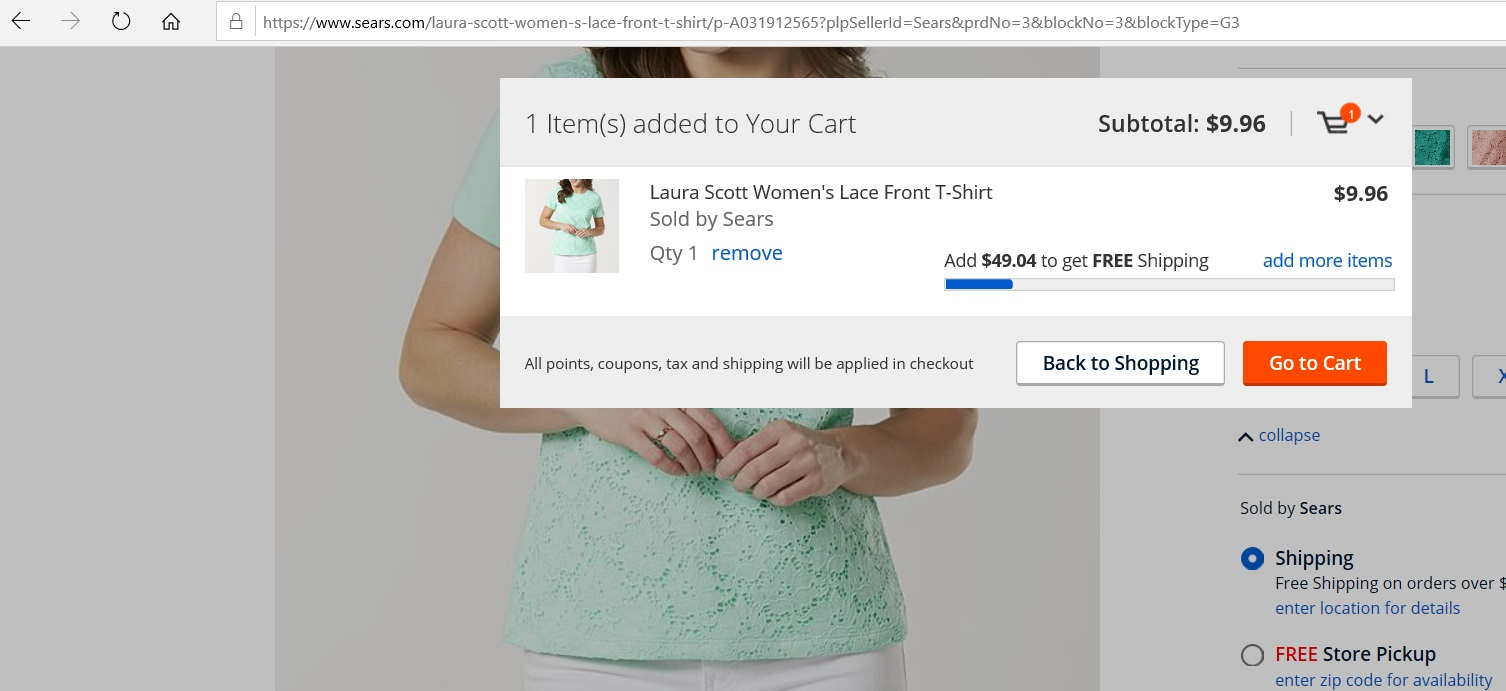 A woman s top added into an online cart.
