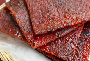 Delicious, traditionally barbecued meat jerky slices - the perfect Singapore Chinese snack for any celebration!